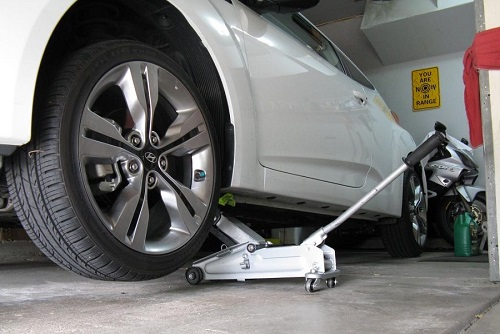Using Floor Jack To Change Oil On Car